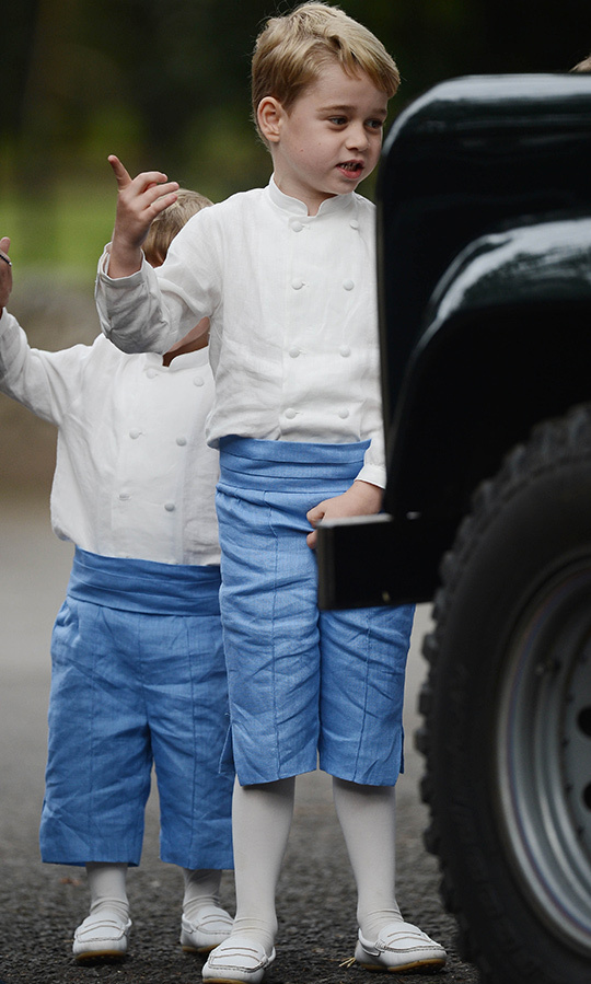 The pageboys, including five-year-old George, wore white collarless double-breasted shirts with blue linen short pants and white tights and penny loafers.