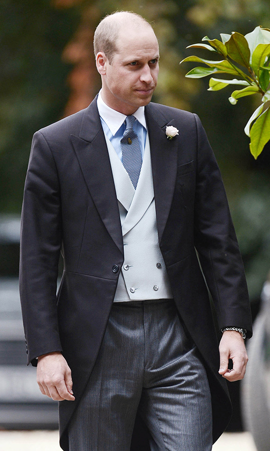 Happily chatting with fellow guests, Prince William looked dapper in his three-piece morning suit, which featured charcoal pants, a light grey vest and black jacket. He wore a small white flower on his lapel.