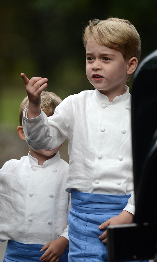 Prince George was pointing something out to his little friends and fellow pageboys.
