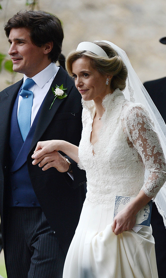 Rupert wore a navy and blue morning suit with a white flower on his lapel, while his bride looked stunning in a halter gown with a lace jacket on top. 