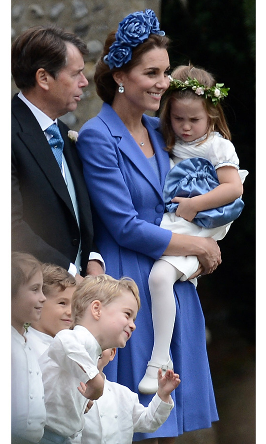 Princess Charlotte was not impressed with Prince George as he goofed around for the camera to the delight of his fellow pageboys. The little girl scowled at her big brother. 