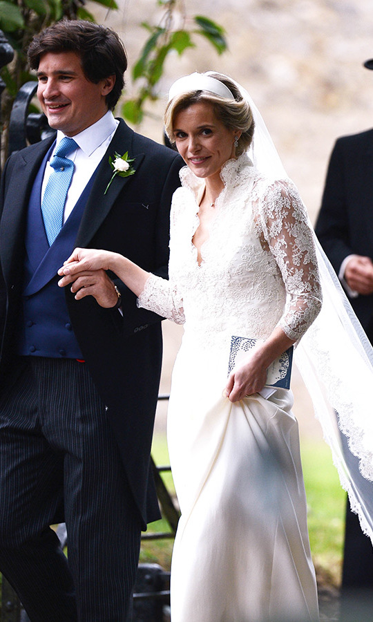 Sophie held up her skirt as she walked holding her husband's hand outside the church in Norfolk, looking every inch the beautiful bride. 