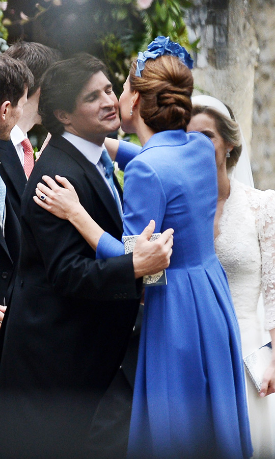 The duchess shared a special moment with groom Rupert outside the church following the ceremony, as she planted a congratulatory kiss on his cheek.