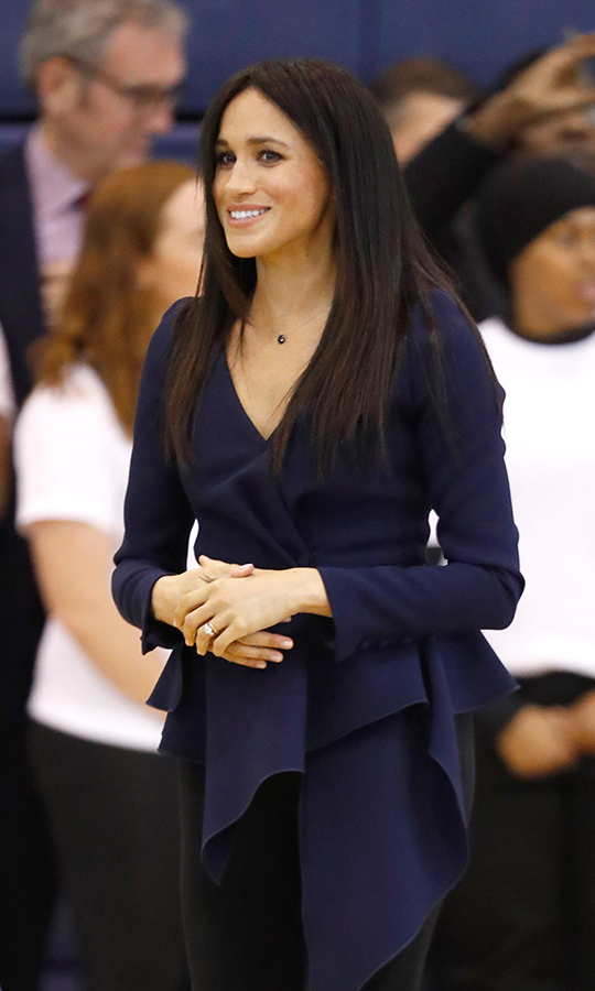 Meghan kept her dark hair sleek and natural for the occasion.