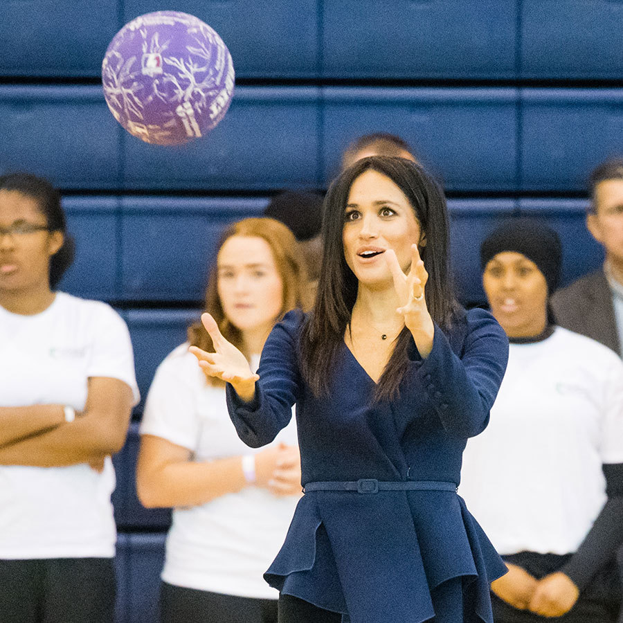 Meghan got the chance to show off her sporty side, joining in on a netball game.