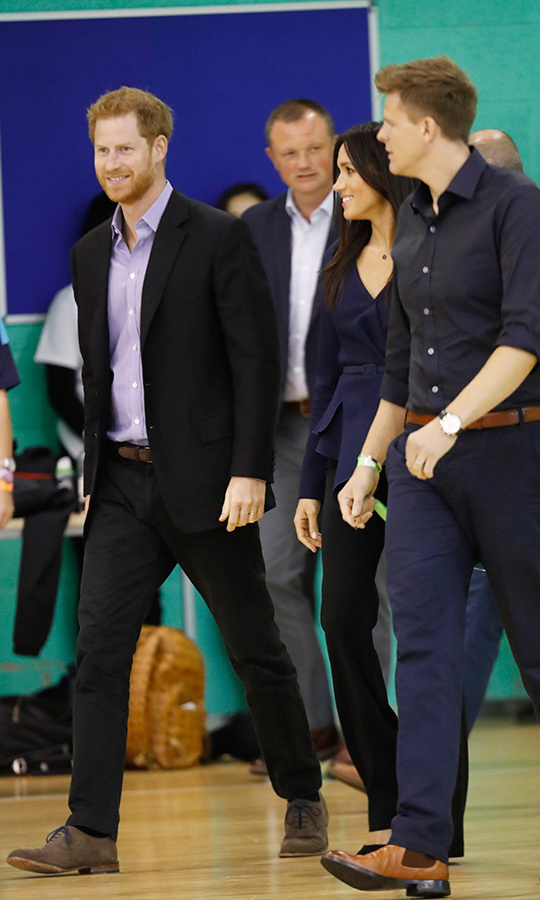 The couple were in high spirits while walking onto the court with one of the organization's officials.