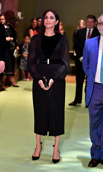 Meghan looked up in awe at one of the pieces of art.