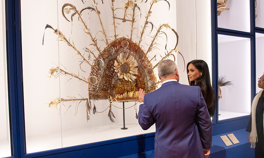 She listened intently while being led around the exhibit, learning the history behind each artifact and artwork.