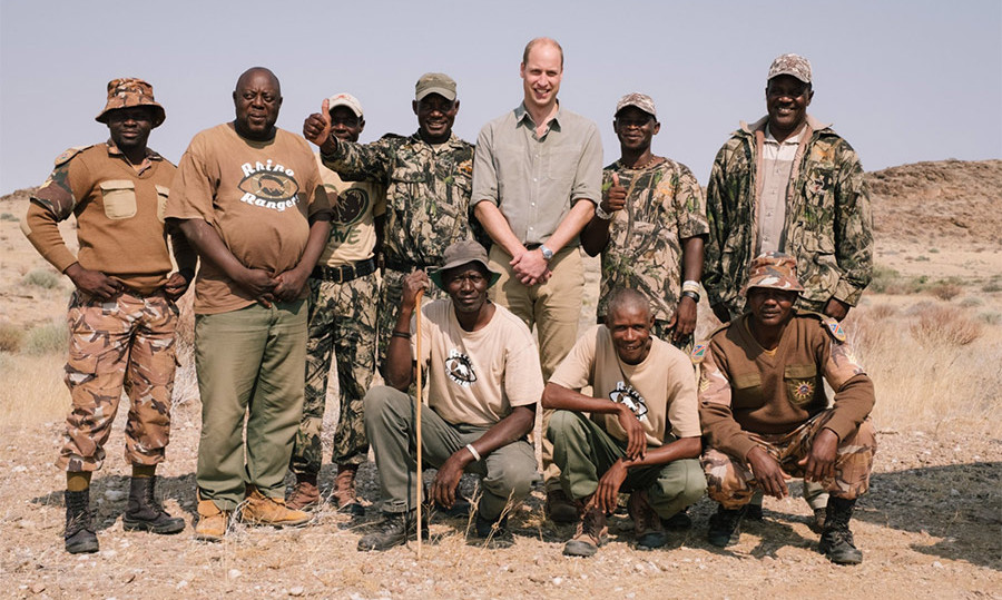 Prince William posed with rangers in Namibia during a hike to find an endangered rhino. 