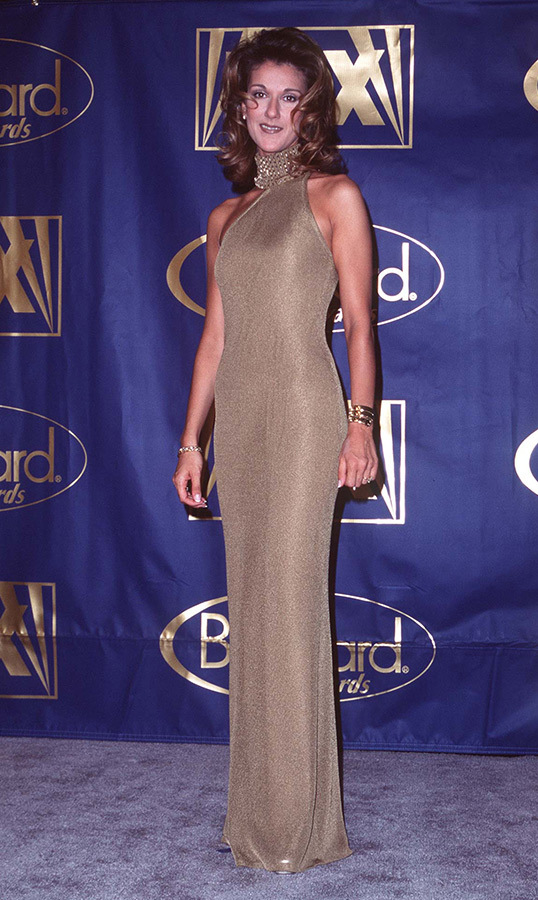 One of Celine's most iconic looks was this amazing gold halter-neck gown, which she wore to the 7th Annual Billboard Music Awards, where she was nominated in 13 categories. She went on to wear quite a few more legendary designs to the same awards show.