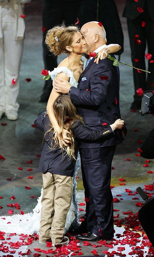 Roses for Celine! The teary eyed star hugged her late husband and their son, Rene-Charles, after the final performance of her show <em>A New Day...</em> at The Colosseum.
