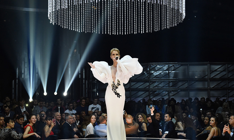 We don't know what we loved more about this evening – the performance or the outfit! Celine wowed the crowd in a white avant-garde Stephane Rolland Haute Couture gown.