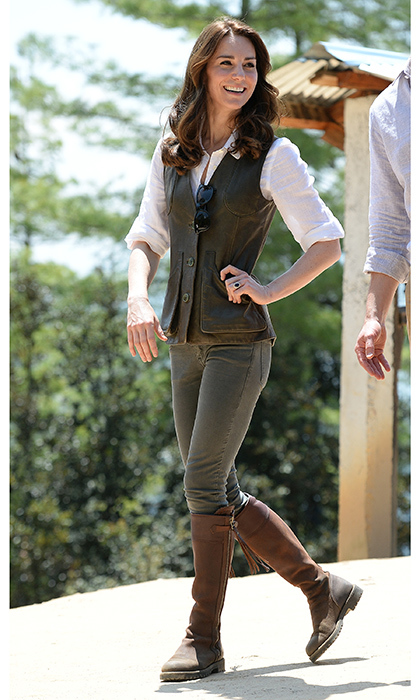 Kate is the queen of safari chic! She dusted off her trusty Penelope Chilvers boots, pairing them with a Jaeger linen blouse and a dark green vest from Really Wild while tackling a hike to Paro Taktsang, the Tiger's Nest monastery, during her 2016 tour of Bhutan.