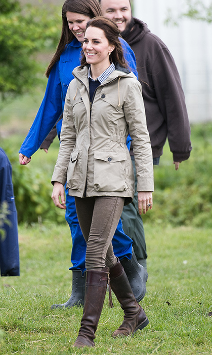 While enjoying a day on the farm, the duchess looked cool as ever in Penelope Chilvers knee-high leather boots, moto-style Zara jeans and a khaki windbreaker. Kate was visiting Farms for City Children, a charity which offers children in the United Kingdom a chance to live and work on a real farm for a week.