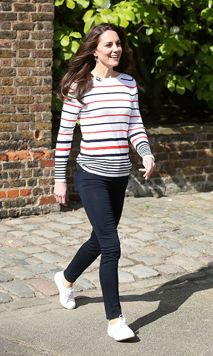 Stripes become her! Kate wore a fun long-sleeved T-shirt, navy pants and crisp white Superga sneakers to a 2017 reception for runners of Team Heads Together, a mental-health awareness campaign started by Kate, Prince Harry and Prince William.