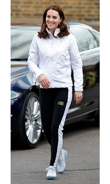 This is definitely one of our favourite sporty Kate looks to date! She rocked a pair of Nike sneakers, Monreal tuxedo pants and a PlayBrave zip-up jacket for her day visiting the Wimbledon Junior Tennis Initiative at Bond Primary School.