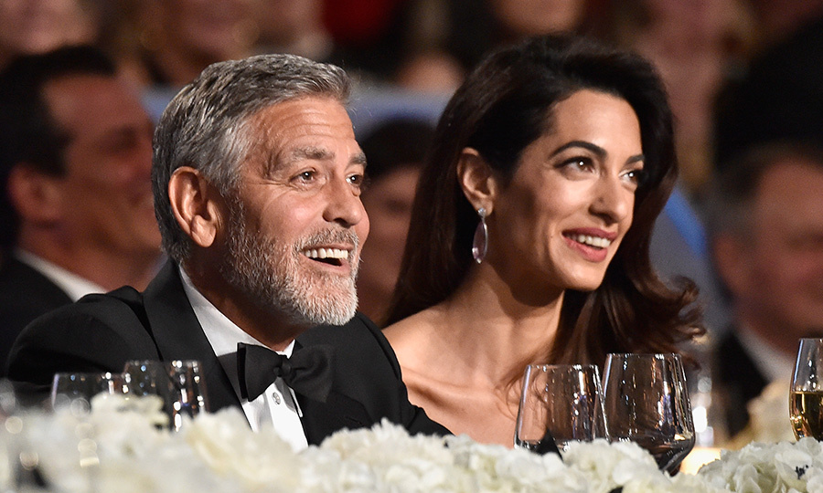 The Clooney twins have an adorable way of showing that they love their food!