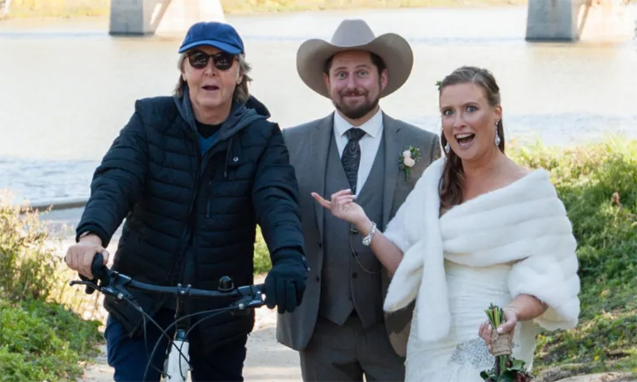 "Winnipeg natives Jen Roscoe and Steve Gregg had the surprise of a lifetime! While taking a set of pre-wedding photos on the city's Waterfront Drive on Sunday (Sept. 30), legendary Beatle Sir Paul McCartney appeared on a bike. The bride-to-be shared with <a href=""https://www.cbc.ca/news/canada/manitoba/paul-mccartney-winnipeg-wedding-photos-1.4845082""><strong><em>CBC</em></strong></a>: ""He went by on the bike ... and he said congratulations as he rode by and Steve said 'that was Paul McCartney.'""