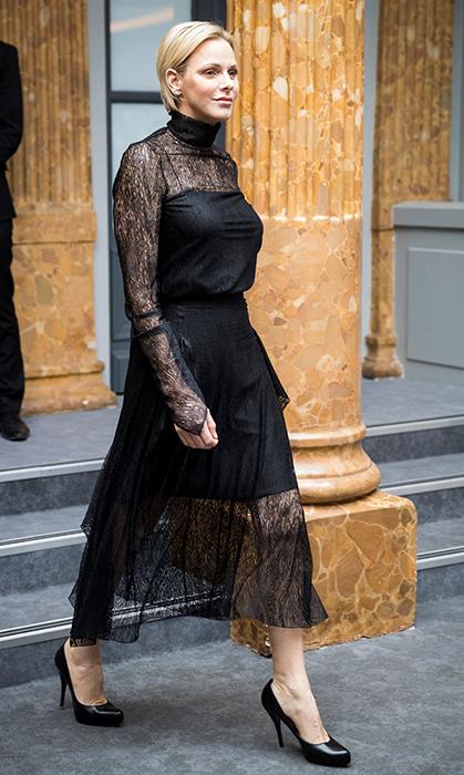 Princess Charlene does it again! Stepping out in the most beautiful black dress, the Monaco royal arrived backstage before the AKRIS show during Paris Fashion Week. The lace gown boasts a high neck and long sleeves, and she paired it with chic patent-leather pumps.