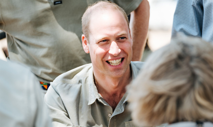 The prince showed off his megawatt smile while meeting with officials of the Save the Rhino Trust Namibia.