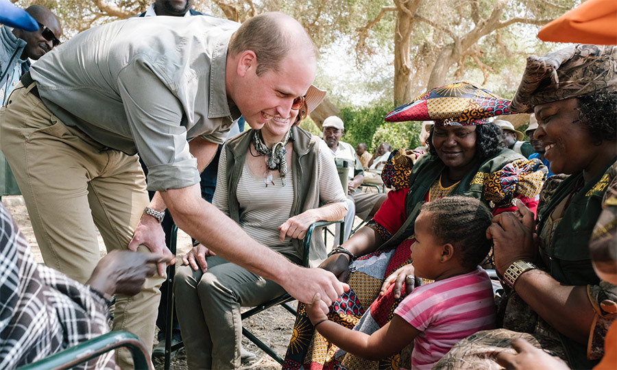 The father of Prince George, Princess Charlotte and Prince Louis shared a special moment with a little girl in Kunene, shaking her hands and later posing for a group photo playfully holding up her arms.