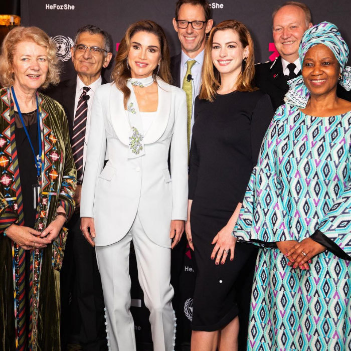 "<a href=""/tags/0/queen-rania/"">Queen Rania</a> posed with Anne Hathaway while attending the HeForShe Impact Summit in New York on Sept. 26. Clad in a striking white suit with pearl detailing on the pants and a scarf tied jauntily around her neck, the Jordanian monarch gave an impassioned speech about the need to empower Arab women, who aren't often at the top of their countries' agendas. ""Empowerment is contagious – I see it lighting up the faces of our youngest girls,"" said the mother of four. ""It's what I call 'the reverse domino effect': lift up one woman, and she'll lift up others, who lift up more.""