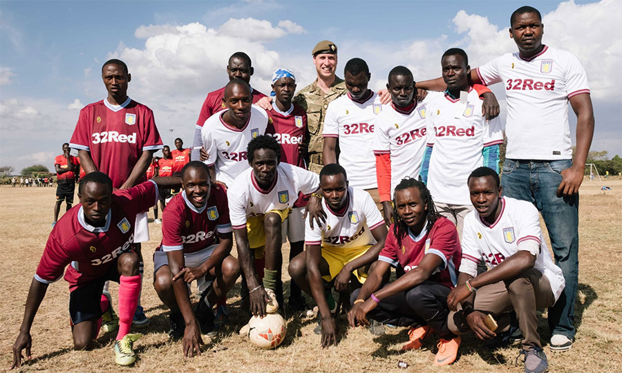 He presented the local football team at Kinamba with Aston Villa shirts!