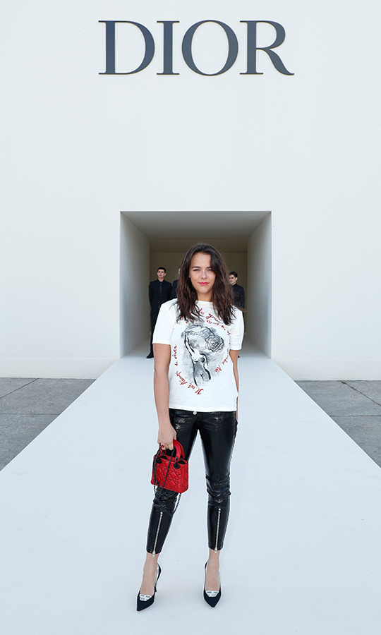 Princess Stephanie of Monaco's eldest daughter, Pauline Ducruet, also posed outside the Dior show in a hard-edged ensemble. The brunette beauty wore a t-shirt with motorcycle pants, pretty embellished pumps and carried a red Dior handbag, which matched her lip colour.