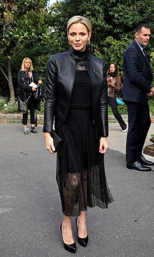 Princess Charlene of Monaco wore an all-black ensemble that was anything but boring at the Akris show in Paris on Sept. 30.  With her short blonde locks in a sleek side-parted 'do, the royal was clad in a long-sleeved lace dress with a leather motorcycle jacket on top. Charlene is a longtime lover of the chic label.