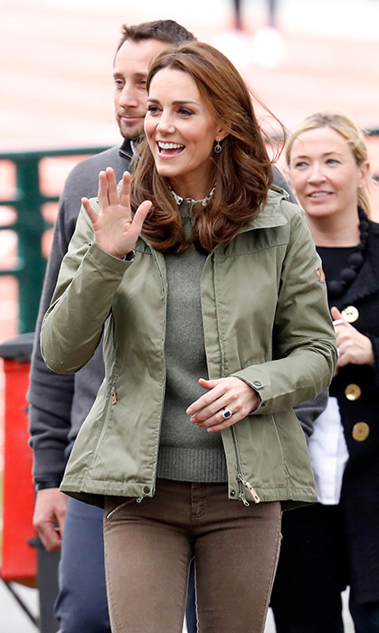 The duchess looked happy as ever to be returning to her royal duties, showing off a sun-kissed glow – leading royal watchers to believe that the Cambridge clan had some major outdoor fun this summer!