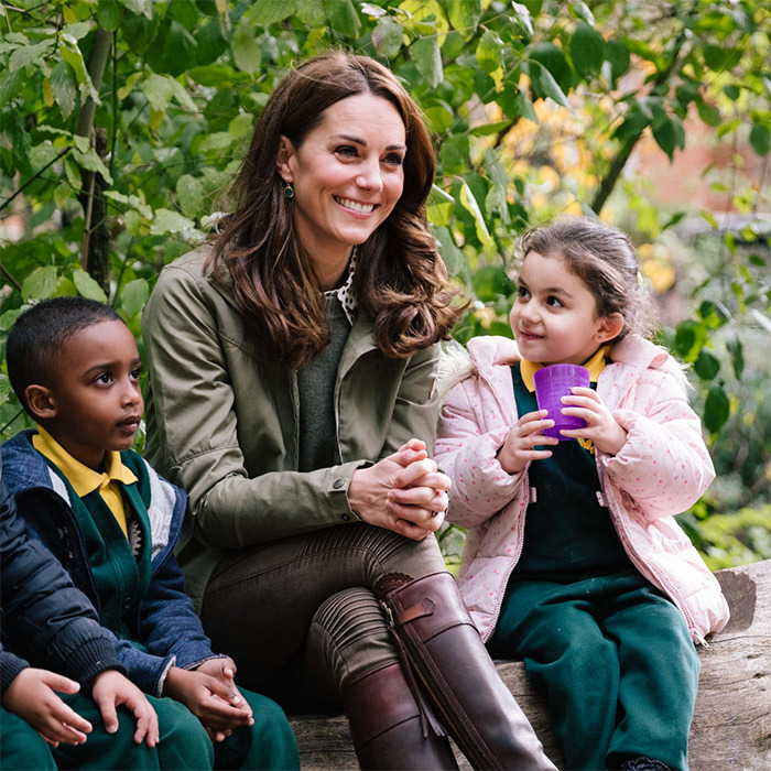 "Kate joined in on an adorable story time at the school, where the children enjoyed a beverage while listening to ""The Monkey Queen"".
