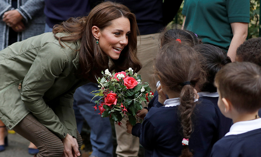 A little girl handed the duchess some flowers.