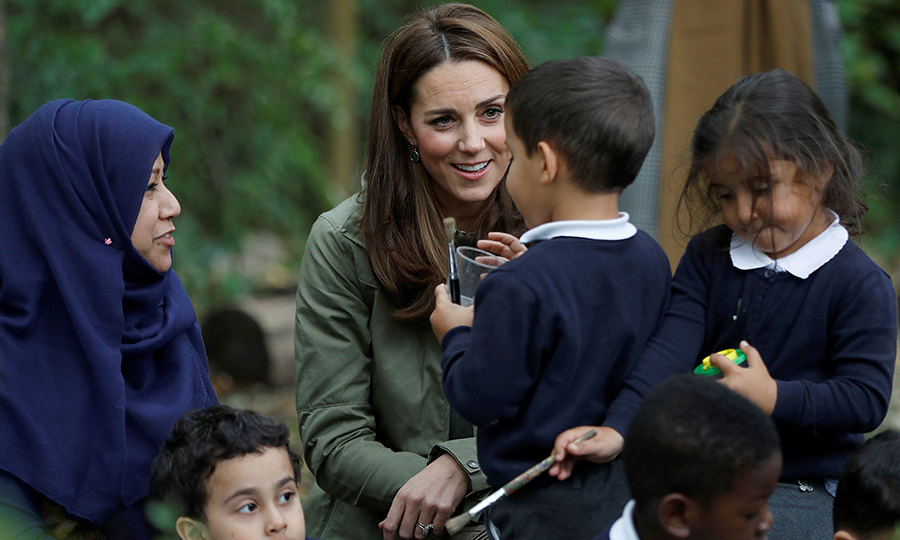 Kate chatted with the students and interacted with teachers, too. One little boy named Mason, 4, from St Augustine's School, showed Kate how to plant pea seeds.