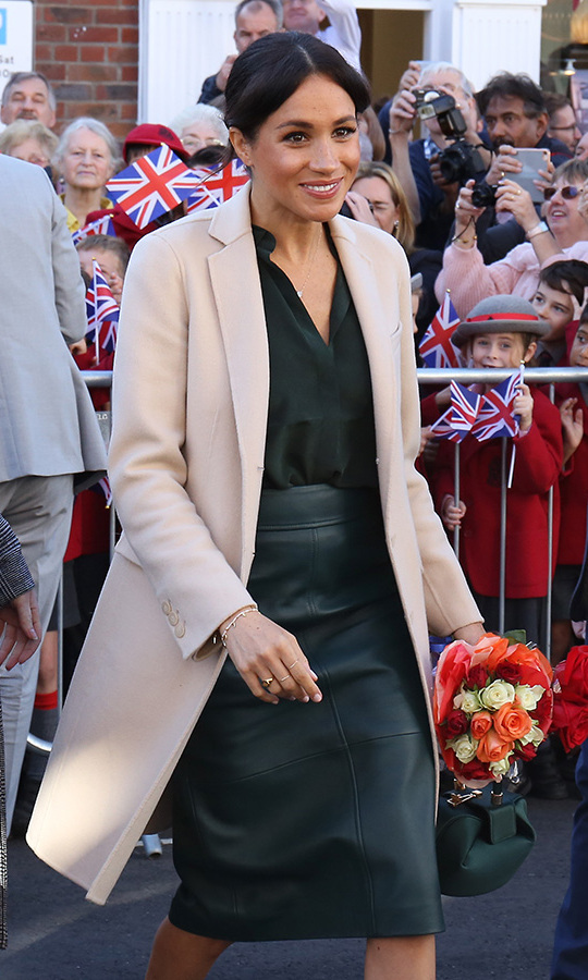 342c79b5b34 Meghan Markle wears a Hugo Boss leather skirt and Armani coat for ...