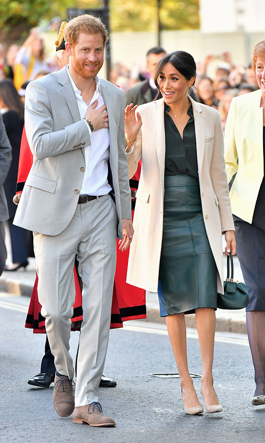 <p>The Duke and Duchess of Sussex touched down in Sussex on Wednesday (Oct. 3) to show the people and places in their namesake county some serious love - from adorable babies to cuddly pooches. Swoon! Prince Harry looked dapper in a light grey suit with a white shirt and taupe oxfords, while Meghan showed off her style savvy once again in a tailored Armani coat with an & Other Stories blouse, leather Hugo Boss skirt and nude Stuart Weitzman pumps.