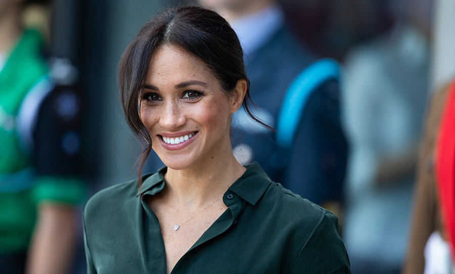 a9d3b2385a1 Meghan Markle turns up the glamour in a chic leather skirt on visit to  Sussex