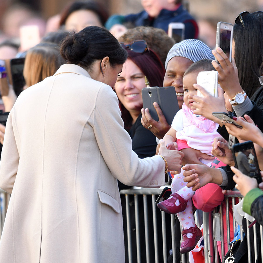 Meghan took a moment to greet an adorable baby girl in Chichester. 