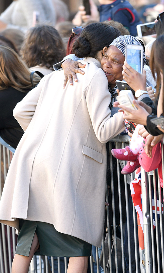 The affectionate duchess gave this adoring fan one of her famously warm hugs.