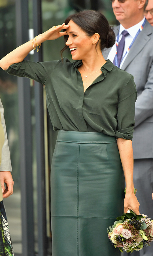 Meghan shielded her eyes from the sun as she showed off her relaxed yet chic ensemble while carrying one of many beautiful bouquets she'd received. The royal wore some new jewellery on her day in Sussex, including the bracelets dangling from her wrist, made by Missoma.