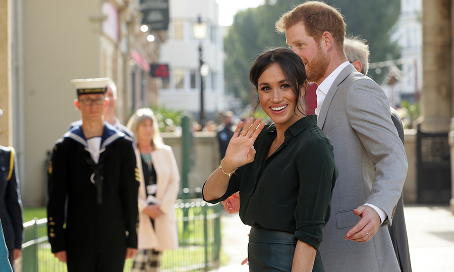 Meghan waved to fans as the couple entered the pavilion in the seaside town of Brighton, the third stop during their busy day in Sussex.