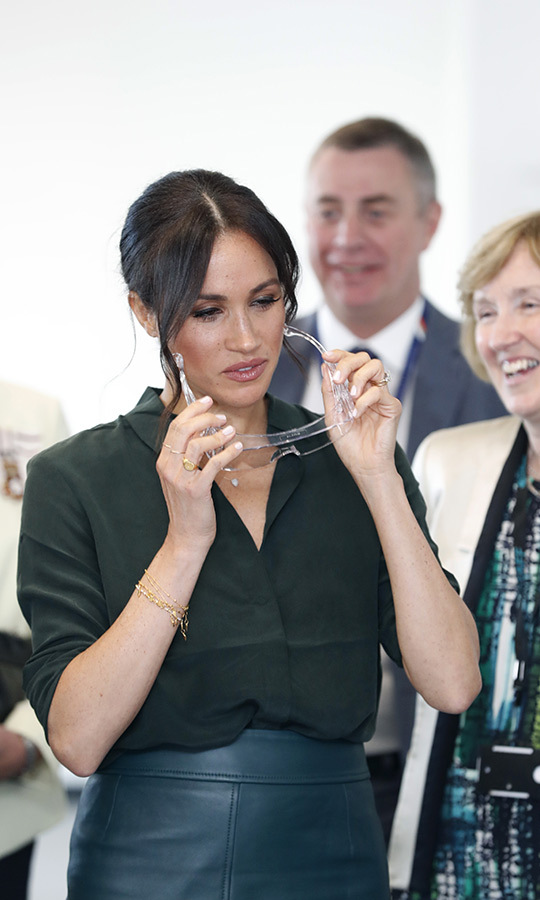 Meghan wore a pretty new signet ring by Missoma on her finger as well as two of her favourite dainty bands.