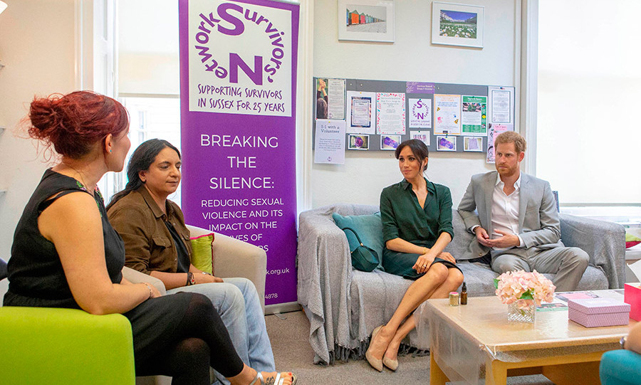 The couple met with volunteers and staff at Survivors' Network in Brighton, which supports survivors of sexual violence and abuse. Meghan showed off her perfected 'Duchess slant.'