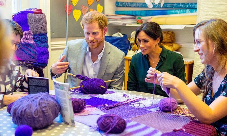 The couple learned about the use of knitting in various shades of purple at the Survivors' Network.