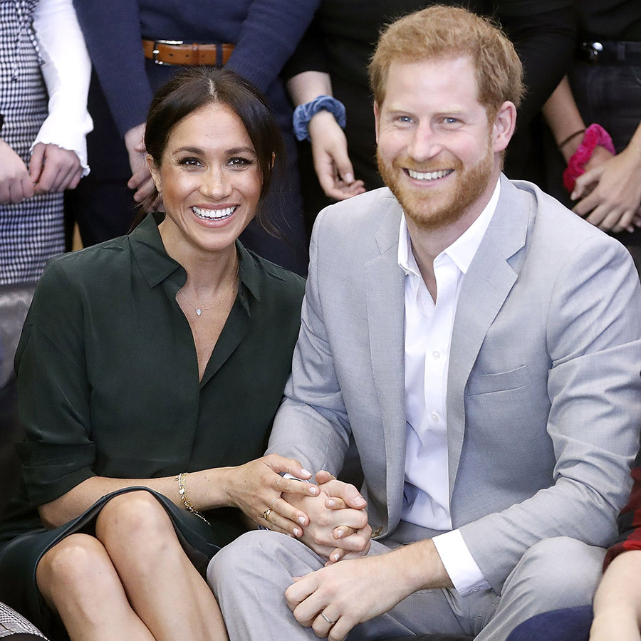 The loved-up couple posed for a group photo at the Joff Youth Centre as they held hands and sat close. With a music room, chill out area and lots of positive areas, the community hub puts the  mental health and emotional wellbeing of young people front and centre. 