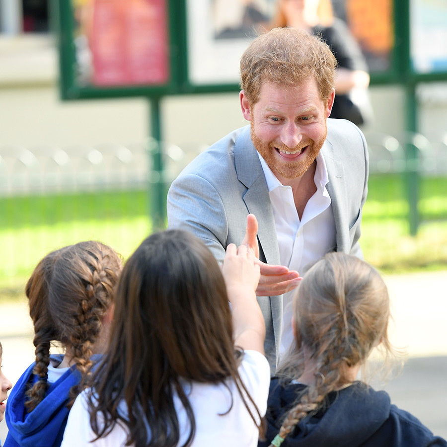 Prince Harry, 36, was shaking hands and giving high fives all day!