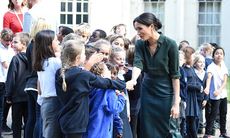 "Meghan shook hands with all the children who had come out to greet the Sussexes at the Royal Pavilion. According to HELLO! royal editor Emily Nash, their conversations with the royal were comical. ""Very funny chatter from the kids as they quiz Meghan: 'How old are you, Miss?' She makes them guess.. 'higher, lower'.""