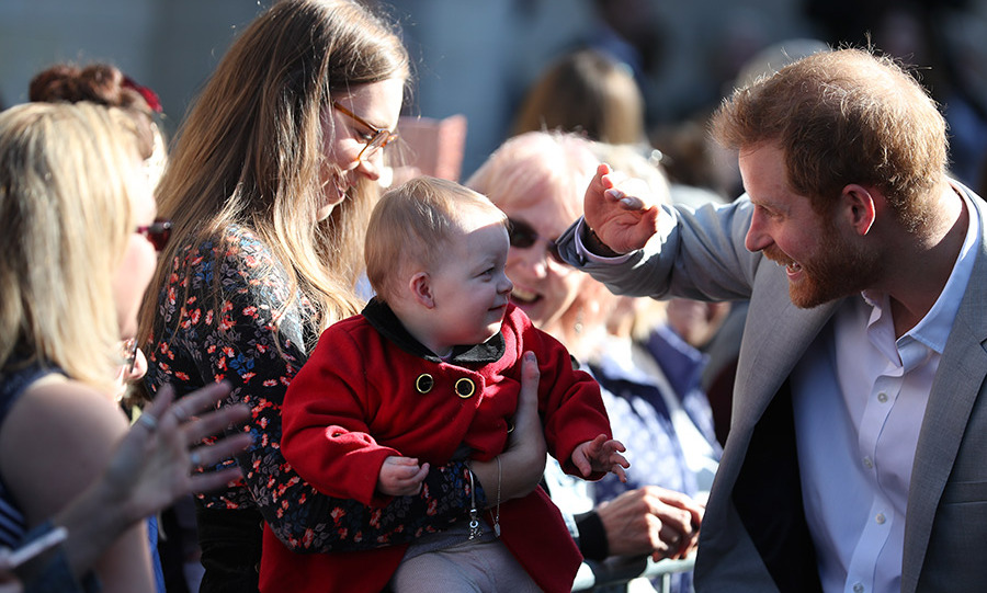 It was a little sunny for this baby! Harry shielded his eyes while chatting with his mom during a walkabout in Sussex, showing off his kind heart.