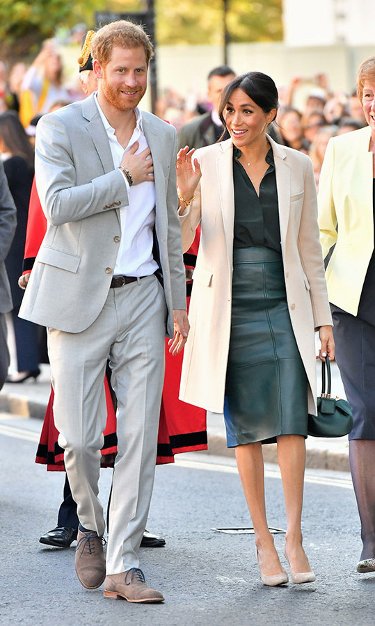 The Duke and Duchess of Sussex made a glamorous pair while on a royal outing in Sussex! Meghan wore a leather Hugo Boss skirt with a  matching & Other Stories blouse and Armani coat, carrying a coveted bag by Gabriela Hearst, while Harry looked dapper in a light grey suit and white shirt. They took in the sites and visited organizations in Chichester, Brighton and Peacehaven.
