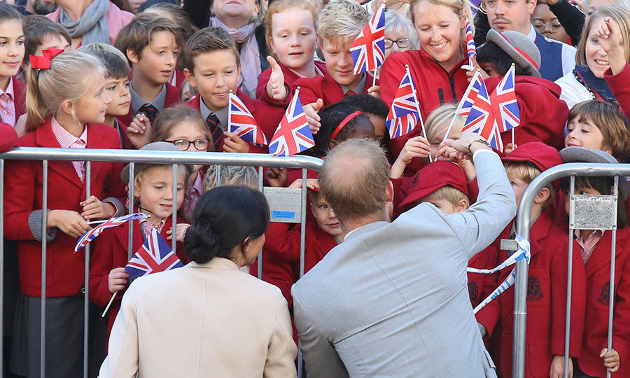 Meghan Markle and Prince Harry stepped out on Oct. 3 to visit their namesake county of Sussex – and of course, they were greeted by a gaggle of adorable school kids!