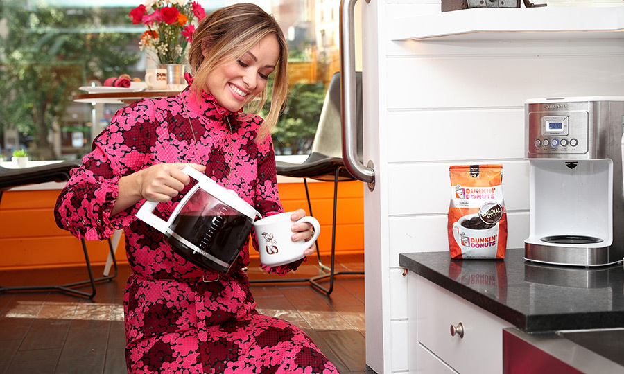 Olivia Wilde looked colourful as ever while pouring herself a cup of Dunkin' Donuts Coffee.
